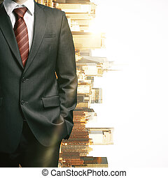 Businessman's body on city background - Close up of...