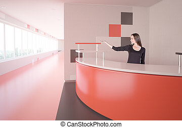Woman at red reception desk