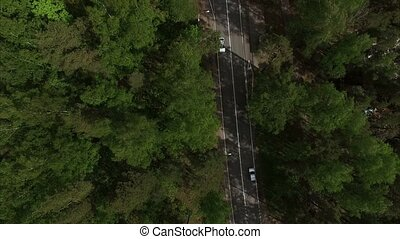 4k aerial view landscape with road in forest - 4k aerial...