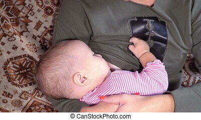 Mother breastfeeding her baby - Happy mom breast feeding her...
