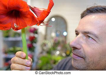 florist composing bouquet