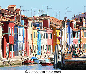 Colourfully painted houses on Burano island near Venice in...