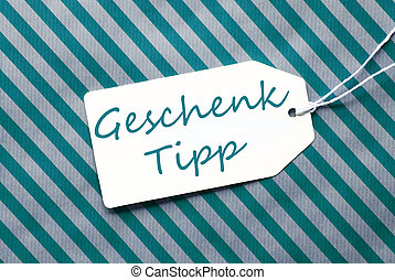 Label On Turquoise Wrapping Paper, Geschenk Tipp Means Gift...
