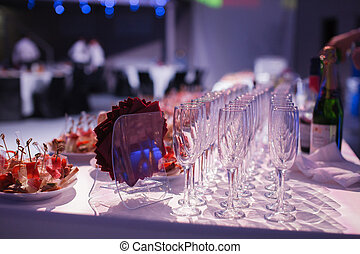 Catering banquet table with baked food snacks, sandwiches,...