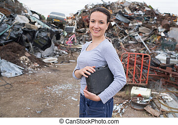 young female manager at dumpsite