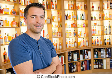 Portrait of man in alcohol store