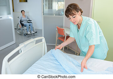 bed in a hospital room