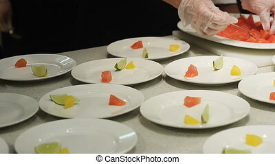 Chef decorate Dishes in Luxury Restaurant