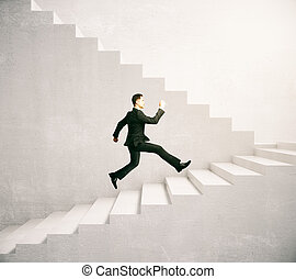 Success concept - Side view of man running up concrete...