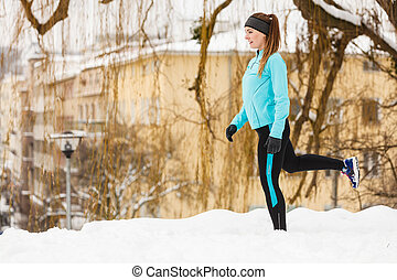 Winter sports, girl exercising in city - Girl exercising in...