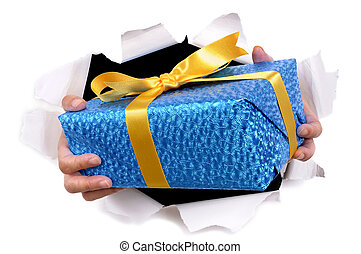 Man hands delivering or giving gift through torn white paper background