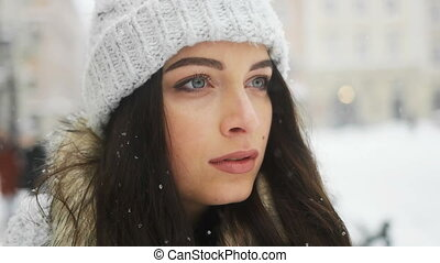 Street emotional portrait of young beautiful woman in city...