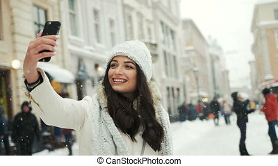 Smartphone woman taking selfie self portrait photo...
