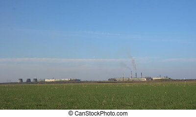 Metall plant with smokestacks. View from Afar
