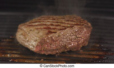 Prepearing a beef steak on a contact grill