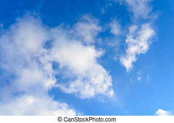 Bright blue sky & puffy clouds as background