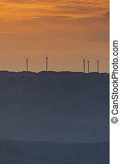 wind farm on top of the mountain