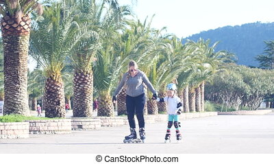 child rollerblading outdoors. sport lifestyle. roller...
