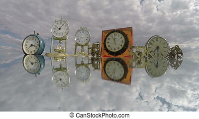 Many clocks on the mirror beneath the cloudy sky, time lapse...