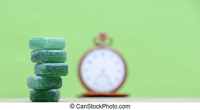 Green mints candy on green background. - picture of a Green...