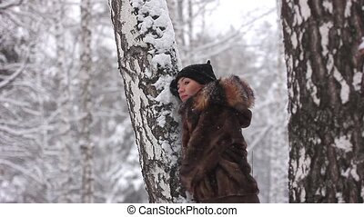 woman in winter forest