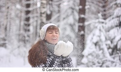 girl blowing on snow - Beautiful Young Smiling Winter Girl...