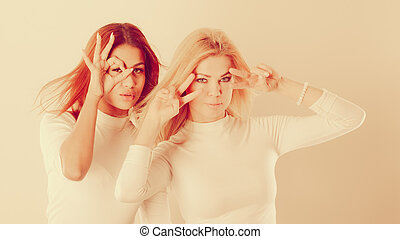 Two crazy girls playing around together. - Friends people...