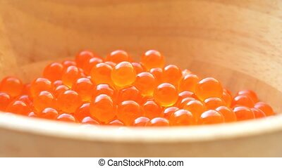 Fresh salmon caviar - Delicious salmon caviar in the wooden...