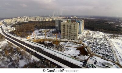 Construction site in the city aerial view at winter