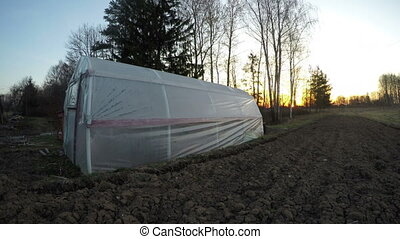Landscape with polyethylene greenhouse, time lapse 4K -...