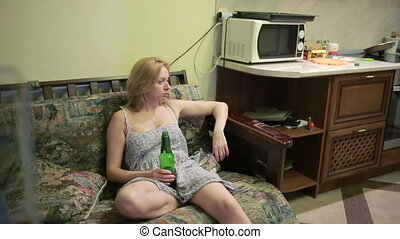 Female alcoholic dependence, woman with a bottle in hands....