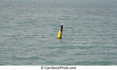 Lonely buoy in the wide sea.