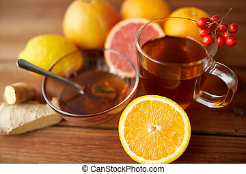 tea with honey, orange and rowanberry on wood - health,...