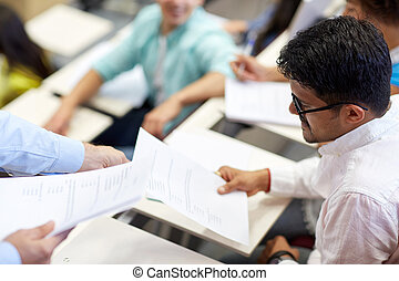 teacher giving exam test to student man at lecture -...