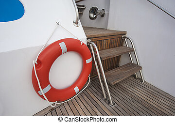 Safety life ring and steps on deck of a yacht - Safety...