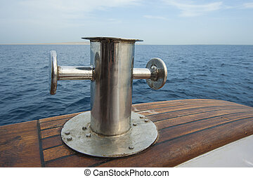 Steel capstan on side of a yacht at sea - Metal steel...