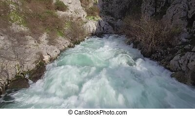 a fast-moving stream of the mountain river in Montenegro