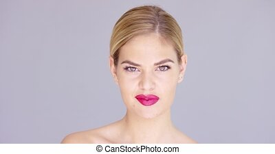 Laughing young woman wearing red lipstick - Laughing...