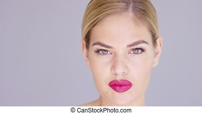 Sensual young woman biting her red lips - Sensual attractive...