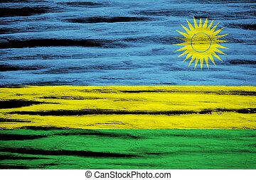 Rwanda Flag on old wood texture