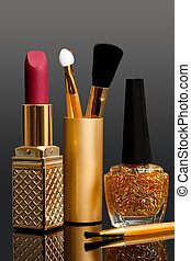lipstick; enamel and cosmetic brushes