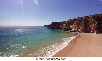 People relaxing by the seaside on the beach of Sagres,...