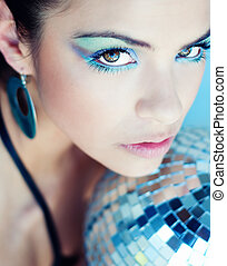 Beautiful disco ball woman with colorful eye makeup