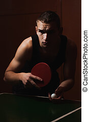 Closeup ping pong, table tennis player, a serious young man...
