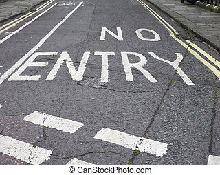 No entry sign written on street tarmac