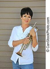 Female trumpet player. - Female trumpet player with her horn...