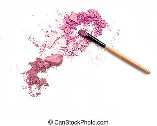 Crushed eyeshadow with brush isolated on white