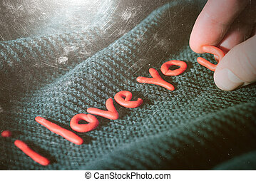 Declaration of love of decorative letters on a black background
