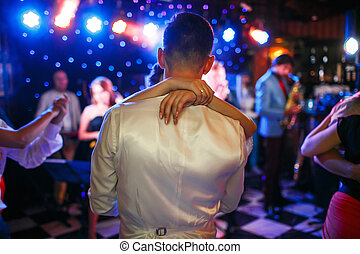 The first dance by brides on the dancefloor