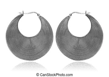 Silver earrings on white background